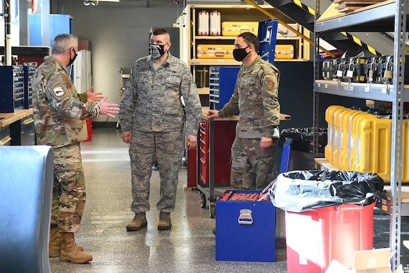 Chief Master Sgt. Kahn Scalise (left), 302nd Airlift Wing command chief, looks at a toolbox with Tech. Sgt. David Buchberger (center) and Senior Airman Manuel Carrillo (right), 302nd Aircraft Maintenance Squadron crew chief and consolidated toolkit custodians, during the November unit training assembly, Nov. 8, 2020, at Peterson-Schriever Garrison, Colorado. Scalise and Col. Christopher Zidek, 302 AW commander,  visited with the reservists and had the opportunity see their mission and discuss successes and challenges. (U.S. Air Force photo by Tech. Sgt. Tiffany Lundberg)