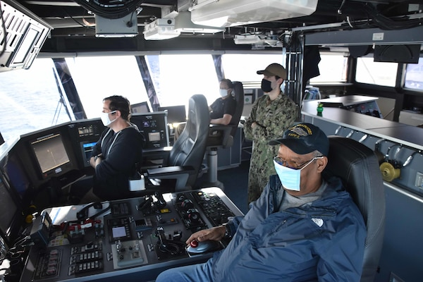 Sailors aboard the expeditionary fast transport ship USNS Millinocket (T-EPF 3) navigate the ship from the bridge.