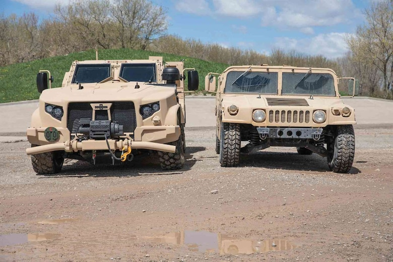 The Air Force Life Cycle Management Center's Agile Combat Support Directorate is working to replace the up-armored High Mobility Multipurpose Wheeled Vehicles, or Humvee (right), with the Joint Light Tactical Vehicles (left). (Courtesy Photo)