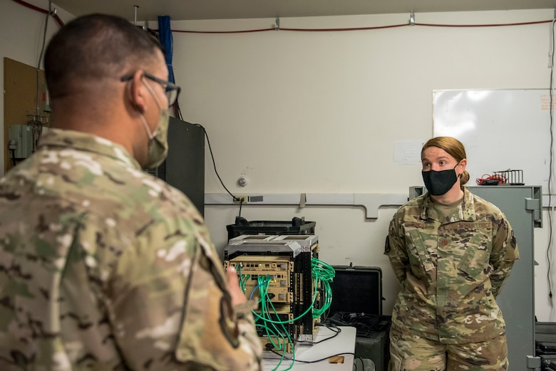 Staff Sgt. Thomas Jara, 27th Special Operations Communications Squadron non-commissioned officer in charge of the tactical local access network team, explains the capabilities of the TACLAN to Maj. Emily Short, 27 SOCS commander, at Cannon Air Force Base, N.M., Nov. 3, 2020. The TACLAN provides network access to more than double the users than if only a satellite was used. (U.S. Air Force photo by Senior Airman Vernon R. Walter III)