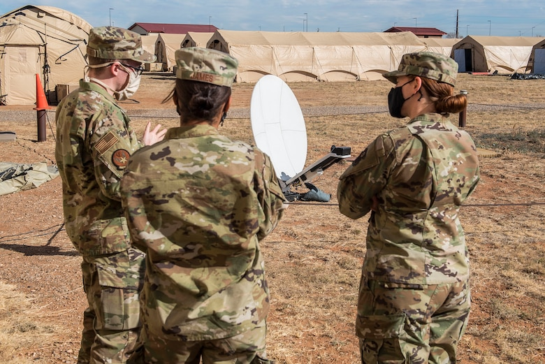 Members of the tactical local access network team show the current satellite being used for their training to Maj. Emily Short, 27th Special Operations Communications Squadron commander, at Cannon Air Force Base, N.M., Nov. 3, 2020. The TACLAN provided over 30 special tactics Airmen with network access to ensure that the teams could have full access to the necessary resources to ensure proper training. (U.S. Air Force photo by Senior Airman Vernon R. Walter III)
