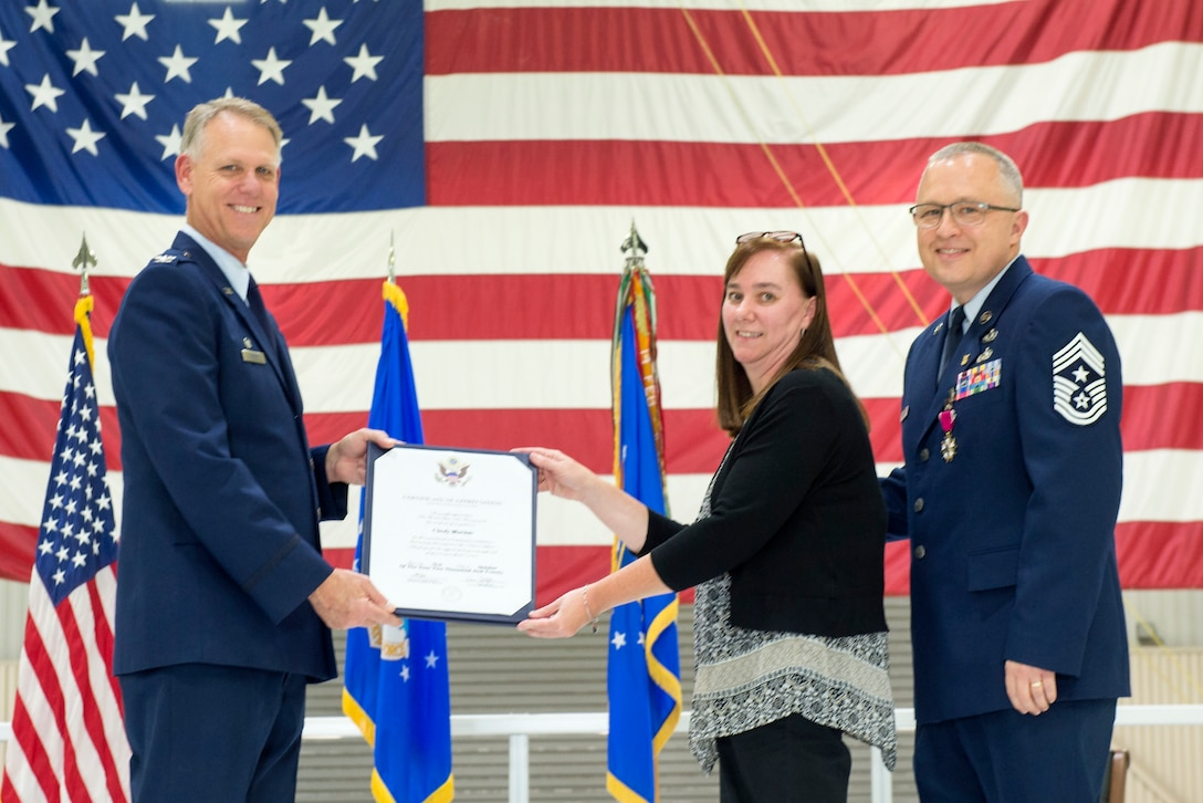 Col. Larry Shaw, 434th Air Refueling Wing commander, presents Cindy Marion, wife of Chief Master Sgt. Wes Marion, 434th ARW command chief, with a certificate of appreciation during her husband's retirement ceremony at Grissom Air Reserve Base, Ind., Nov. 8, 2020. In addition to supporting her husband's military career, Cindy supported all of Grissom Airman by serving in the Key Spouse program since 2016 as a Key Spouse Wing mentor. (U.S. Air Force photo/Master Sgt. Ben Mota)