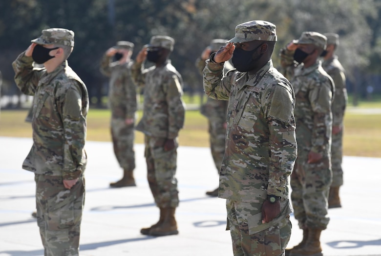 Graduating basic military training trainees render a salute during the final BMT graduation ceremony on the Levitow Training Support Facility drill pad at Keesler Air Force Base, Mississippi, Nov. 6, 2020. Nearly 60 trainees from the 37th Training Wing Detachment 5 completed the six-week BMT course. Throughout the duration of BMT training at Keesler, 18 flights and 939 Airmen graduated. (U.S. Air Force photo by Kemberly Groue)
