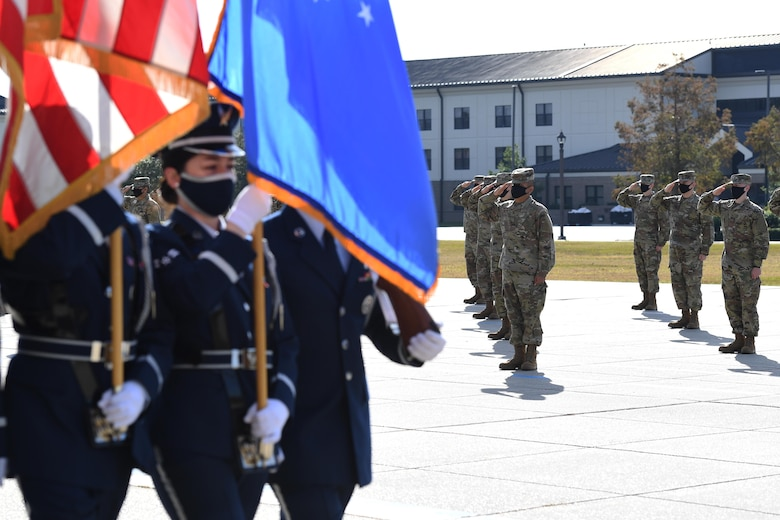 The Keesler Honor Guard marches off of the Levitow Training Support Facility drill pad during the final basic military training graduation ceremony at Keesler Air Force Base, Mississippi, Nov. 6, 2020. Nearly 60 trainees from the 37th Training Wing Detachment 5 completed the six-week BMT course. Throughout the duration of BMT training at Keesler, 18 flights and 939 Airmen graduated. (U.S. Air Force photo by Kemberly Groue)