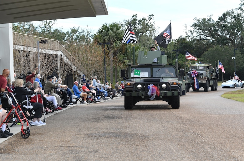 U.S. Air Force Maj. Gen. Craig Wills, Nineteenth Air Force commander, Joint Base San Antonio-Randolph, Texas, rides in the Gulf Coast Veteran's Day Roll-Thru and Wave Parade outside the Armed Forces Retirement Home at Gulfport, Mississippi, Nov. 7, 2020. Keesler Air Force Base leadership also participated in the parade in support of all veterans past and present. (U.S. Air Force photo by Kemberly Groue)