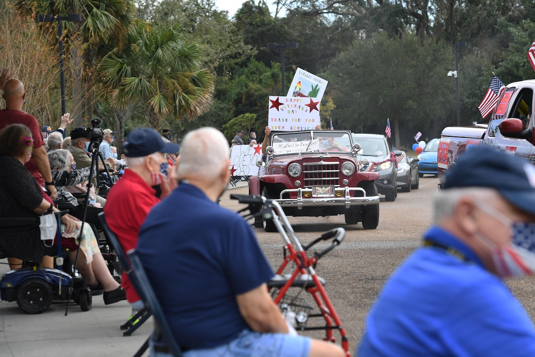 Gulf Coast veterans participate in the Gulf Coast Veteran's Day Roll-Thru and Wave Parade outside the Armed Forces Retirement Home at Gulfport, Mississippi, Nov. 7, 2020. Keesler Air Force Base leadership participated in the parade in support of all veterans past and present. (U.S. Air Force photo by Kemberly Groue)