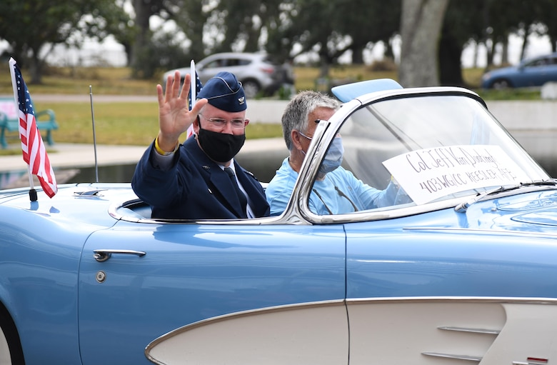 U.S. Air Force Col. Jeff Van Dootingh, 403rd Wing commander, waves to veterans during the Gulf Coast Veteran's Day Roll-Thru and Wave Parade outside the Armed Forces Retirement Home at Gulfport, Mississippi, Nov. 7, 2020. Keesler Air Force Base leadership participated in the parade in support of all veterans past and present. (U.S. Air Force photo by Kemberly Groue)