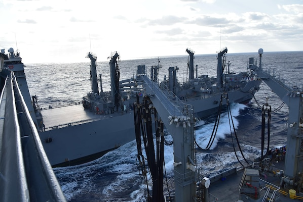 The Japan Maritime Self-Defense Force Mashū-class replenishment ship Mashū (AOE-425) receives fuel from the U.S. Navy Military Sealift Command Henry J. Kaiser-class fleet replenishment oiler USNS Tippecanoe (T-AO 199) during an underway replenishment as part of Keen Sword.
