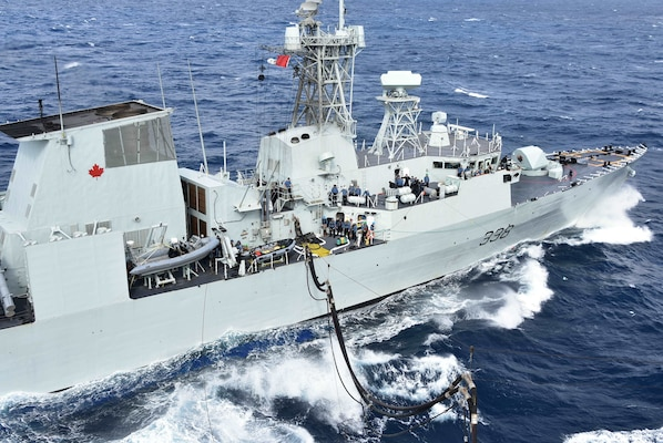 HMCS Winnipeg (FFH 338), a Halifax-class frigate in the Royal Canadian Navy fleet, receives a refueling probe from the U.S. Navy Military Sealift Command Henry J. Kaiser-class fleet replenishment oiler USNS Tippecanoe (T-AO 199) in preparation for an underway replenishment during Keen Sword.