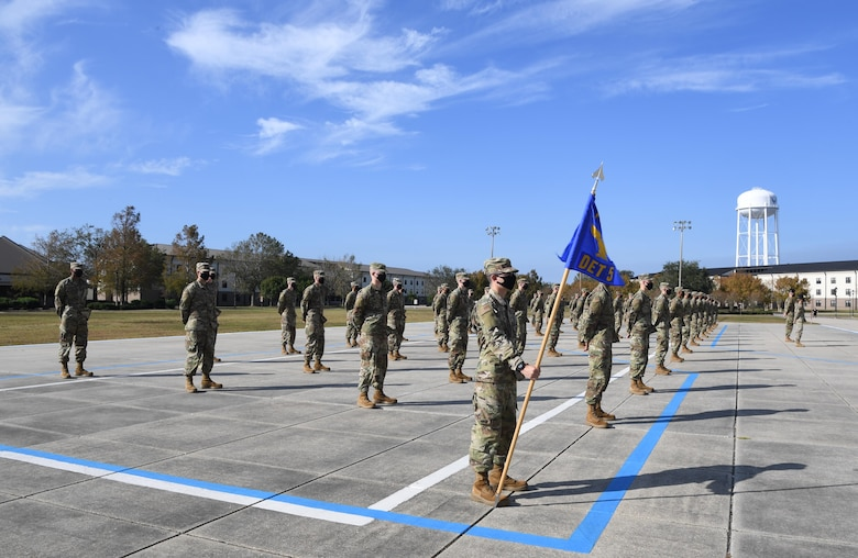 Graduating basic military training trainees stand in formation on the Levitow Training Support Facility drill pad during the final BMT graduation ceremony at Keesler Air Force Base, Mississippi, Nov. 6, 2020. Nearly 60 trainees from the 37th Training Wing Detachment 5 completed the six-week BMT course. Throughout the duration of BMT training at Keesler, 18 flights and 939 Airmen graduated. (U.S. Air Force photo by Kemberly Groue)