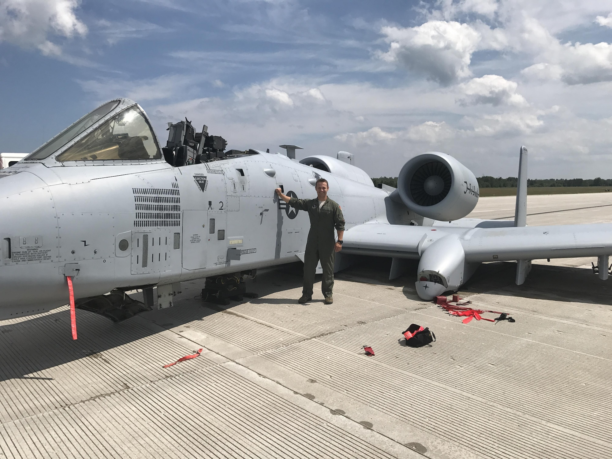 Capt. Brett DeVries, an A-10 Thunderbolt II pilot of the 107th Fighter Squadron from Selfridge Air National Guard Base, next to the aircraft he safely landed after a malfunction forced him to make an emergency landing July 20, 2017, at the Alpena Combat Readiness Training Center. For his efforts, DeVries was awarded the Distinguished Flying Cross Nov. 6, 2020.