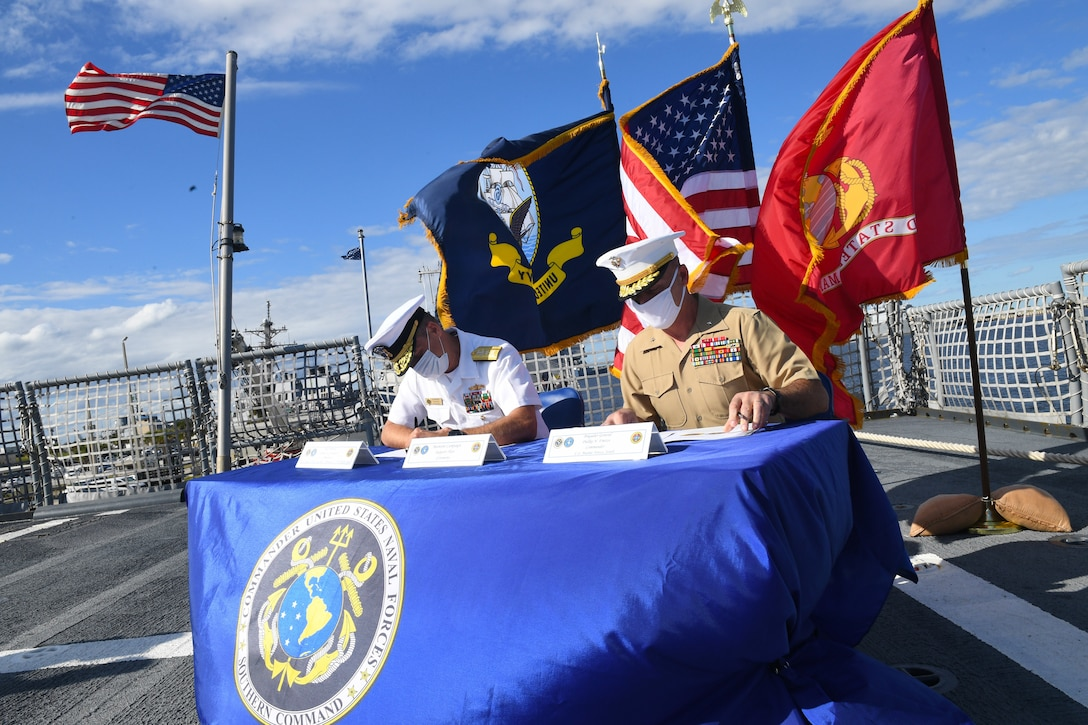 Rear Adm. Don Gabrielson and Brig. Gen. Phillip Frietze, sign the Joint Maritime Component Commander Maritime Campaign Support Plan in a ceremony aboard USS Wichita (LCS 13), Nov. 4.