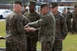 Maj. Gen. James F. Glynn passes a piece of the cake to the guest of honor, Lt. Gen. George W. Smith during the 245th Marine Corps Birthday cake cutting ceremony at Camp Lejeune, North Carolina, Nov. 6.