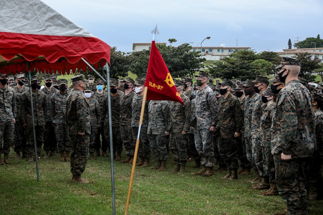 "A U.S. Marine leads Marines in singing ""The Marines' Hymn"" in celebration of the Marine Corps' 245th birthday on Camp Kinser, Okinawa, Japan, Nov. 9."