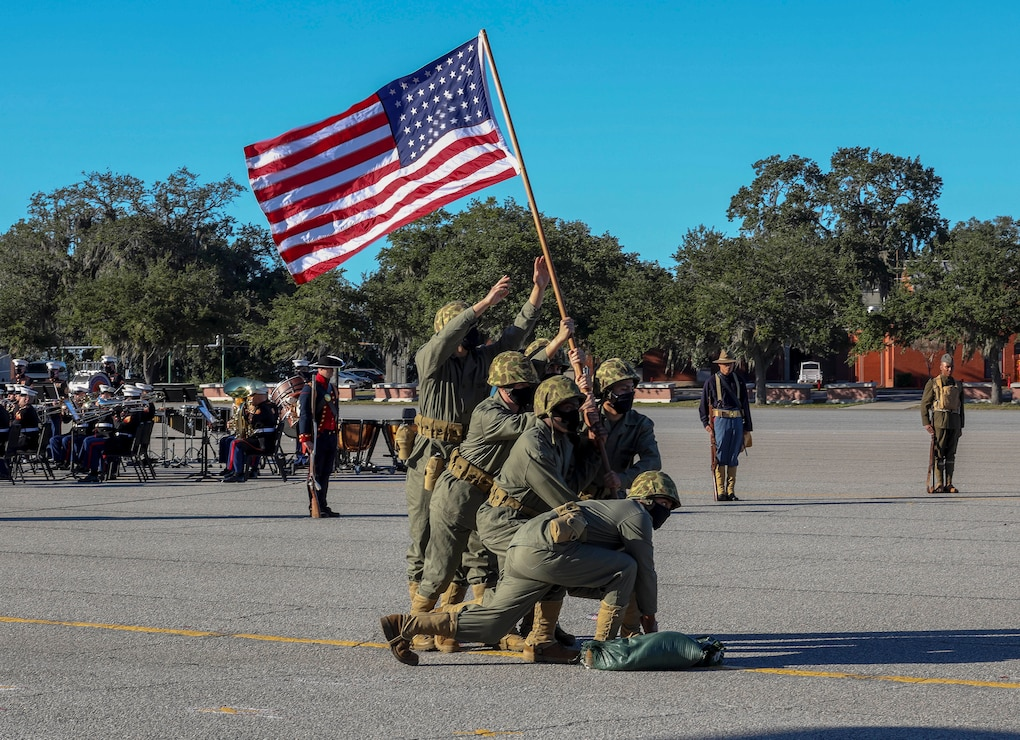 U.S. Marines and Sailors reenact the flag raising from the battle of Iwo Jima Marine during the MCRDPI birthday pageant at the Peatross Parade Deck aboard MCRDPI, S.C., Nov. 4.