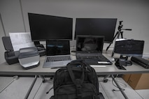 a group of computer equipment sits on a table.