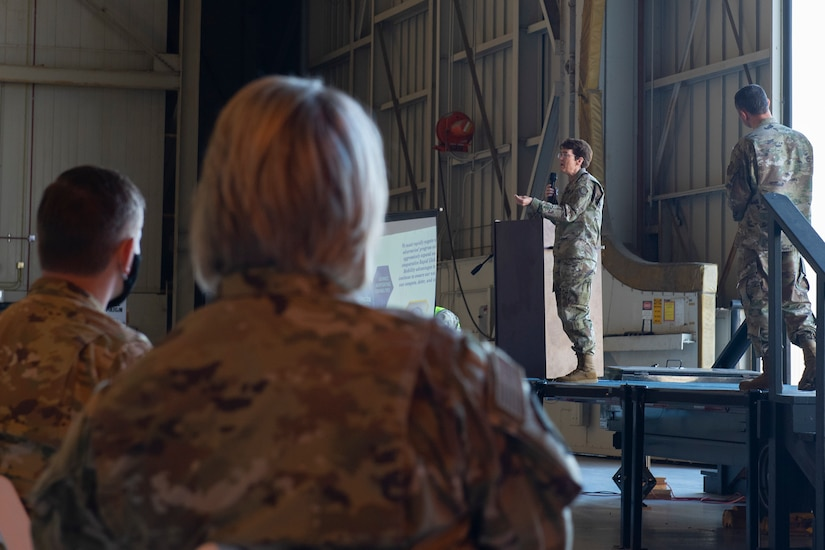 Gen. Jacqueline Van Ovost, Air Mobility Command commander, speaks at an all call at Joint Base Charleston, S.C., Nov. 5, 2020. Van Ovost, her husband Alan Frosch, and Chief Master Sgt. Brian Kruzelnick, AMC command chief, visited members of Joint Base Charleston as part of their listening tour. Their trip centered on meeting members of Team Charleston, highlighting their accomplishments and learning about their specific mission sets.