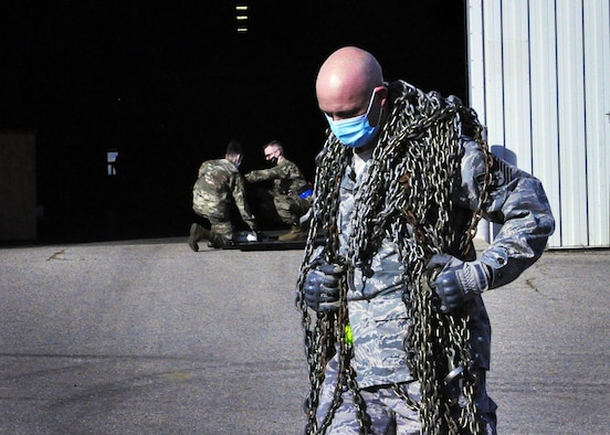 Tech. Sgt. John Hardisky, 87th Aerial Port Squadron cargo processing supervisor, hauls cargo chains across a competition course during the 87th Aerial Port Squadron's semi-annual Port Dawg Challenge Oct. 17, 2020. Port Dawgs rely on chains to secure a variety of cargo types for military airlift.