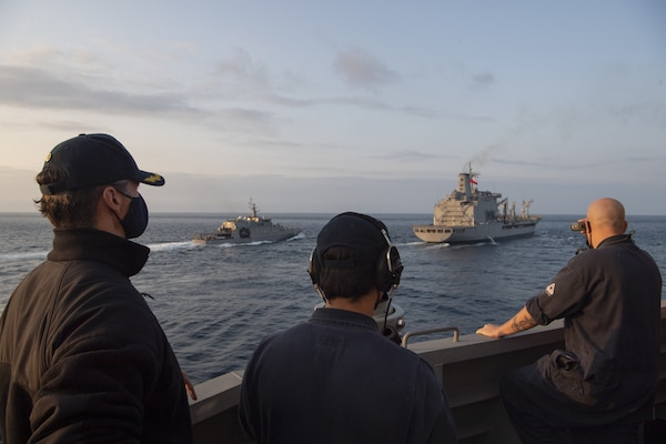 Cmdr. Rion Martin, commanding officer of Independence-class littoral combat ship USS Gabrielle Giffords (LCS 10), oversees a replenishment-at-sea (RAS) with Chilean Navy replenishment oiler CNS Almirante Montt (AO-52) Nov. 7, 2020.