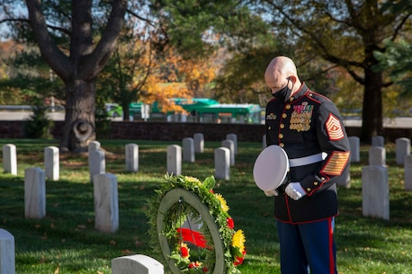 The 19th Sergeant Major of the Marine Corps, Sgt. Maj. Troy E. Black and the Marine Barracks Washington Sergeant Major, Sgt. Maj. Adrian Tagliere, pay tribute to Sgt. Maj. Gilbert Johnson at the Arlington National Cemetery following the Marine Corps Birthday Wreath Laying Ceremony, Arlington Va., Nov. 10, 2020. Johnson was one of the first African Americans to enlist in the United States Marine Corps. The ceremony is an annual event held at the Marine Corps War Memorial to honor the Corps' birthday. (U.S. Marine Corps photo by Sgt. Victoria Ross)