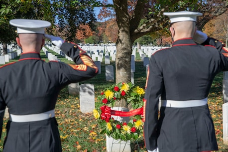 The 19th Sergeant Major of the Marine Corps, Sgt. Maj. Troy E. Black and the Marine Barracks Washington Sergeant Major, Sgt. Maj. Adrian Tagliere, pay tribute to Pvt. Robert Maulding at the Arlington National Cemetery following the Marine Corps Birthday Wreath Laying Ceremony, Arlington Va., Nov. 10, 2020. Maulding was chosen in honor of the 75th anniversary of World War II. Maulding was one of the first enlisted killed in action during the war. (U.S. Marine Corps photo by Sgt. Victoria Ross)