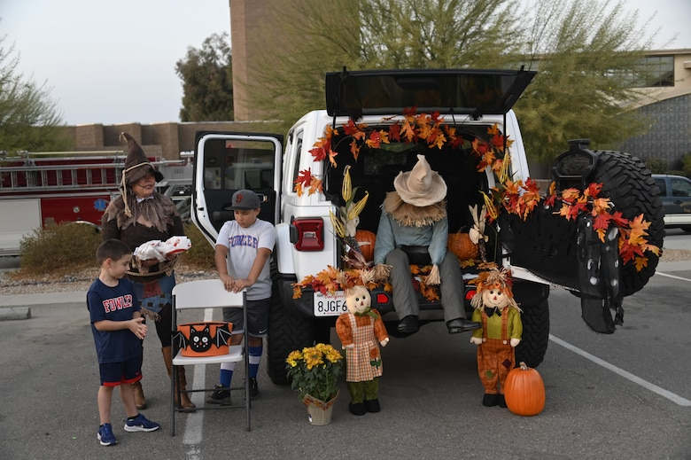 Airmen of the 144th Fighter Wing and their families attend a trunk-or-treat hosted at the Fresno Air National Guard base Oct. 23.