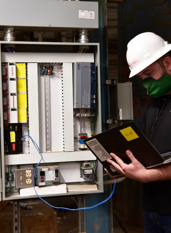 Honeywell technician, John Sutton checks the control panel. There are over 120,000 data collection points coming into the system.