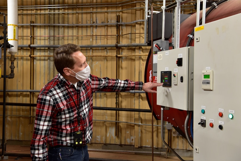 Joseph Cecrle, OC-ALC energy manager, checks the control panel on a new process steam boiler in one of many distributed systems that replaced the old centralized steam plant.