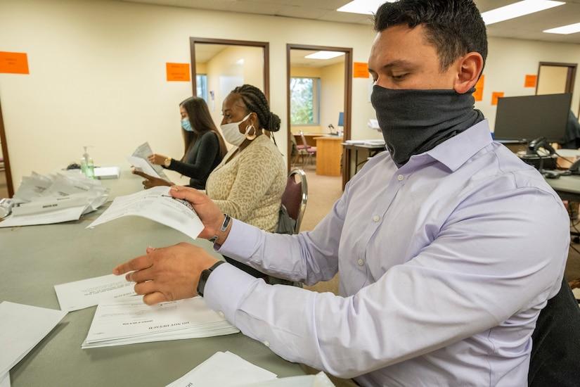 Airmen process ballots.