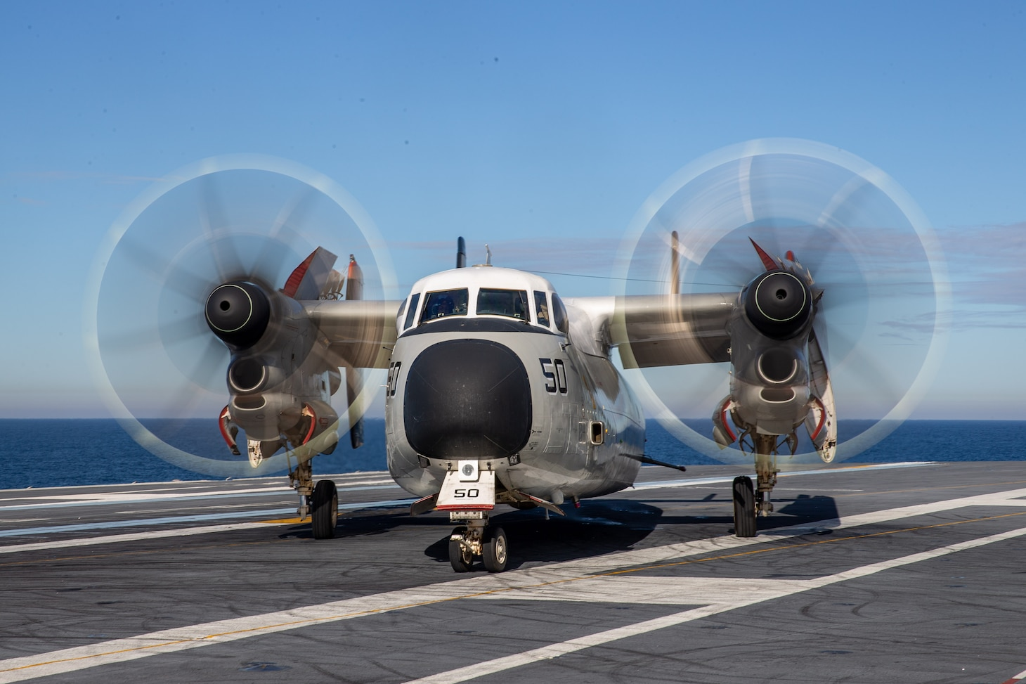 "A C-2A Greyhound, attached to the ""Rawhides"" of Fleet Logistics Support Squadron (VRC) 40 taxis aboard USS Gerald R. Ford's (CVN 78) flight deck Nov. 8, 2020"