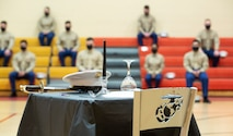 NORFOLK, VA (November 10, 2020) – A U.S. Marine Corps honorary fallen comrade table sits on display during a Fleet Marine Force Atlantic, U.S. Marine Corps Forces Command Marine Corps birthday ceremony at the Camp Elmore gymnasium. Marines commemorated the Marine Corps 245th birthday by highlighting its rich traditions, and honoring those who serve and have served in the Corps. (U.S. Marine Corps photo by Jonathan Donnelly/Released)