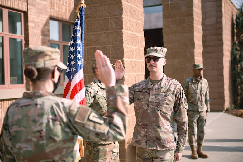 Maj. Meghan Smith, chief of public affairs for the 158th Fighter Wing, Vermont Air National Guard, conducts the oath of enlistment for Tech. Sgt. Richard Mekkri, Vermont Air National Guard Base, South Burlington, Vt., Nov. 7, 2020. With the enlistment of Mekkri, transferring from the Air Force Reserves, the wing reached 1,000 members for the first time in several years since it began converting from the F-16 to the F-35A Lightning II.