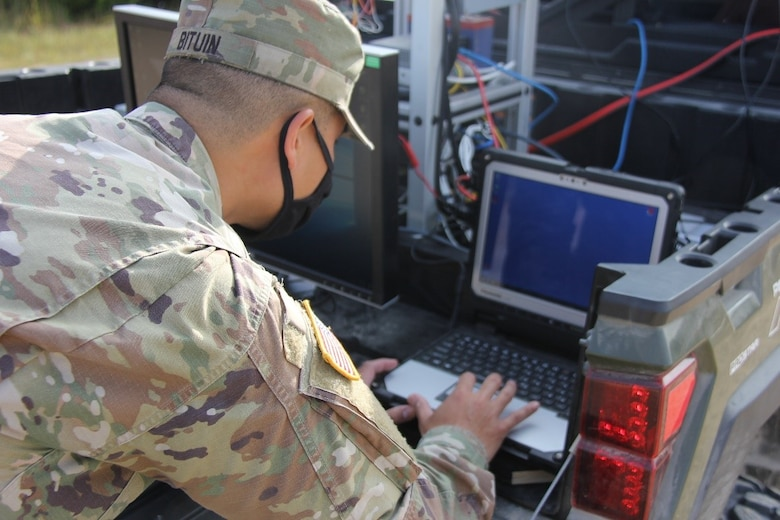 A Soldier stationed on Fort Leonard Wood, Mo., commands the computer system for the Mobility System for Crossing Off-Road and Urban Terrain (M-SCOUT) unmanned aerial vehicle (UAV) and prepares the unmanned aerial vehicle for system launch during the Maneuver Support, Sustainment and Protection Integration Experiments-2020, or MSSPIX-20, in Fort Leonard Wood, Sept. 16, 2020. The U.S. Army Engineer Research and Development Center researchers worked with Soldiers to test M-SCOUT during MSSPIX-20. M-SCOUT is a prototype warning system mounted inside a ground vehicle that displays mobility obstacles on a map, detected from a sensor data cloud on-board an unmanned aerial system. The live terrain data is combined with mobility performance models to updated routes and provide situational awareness to convoy commanders.