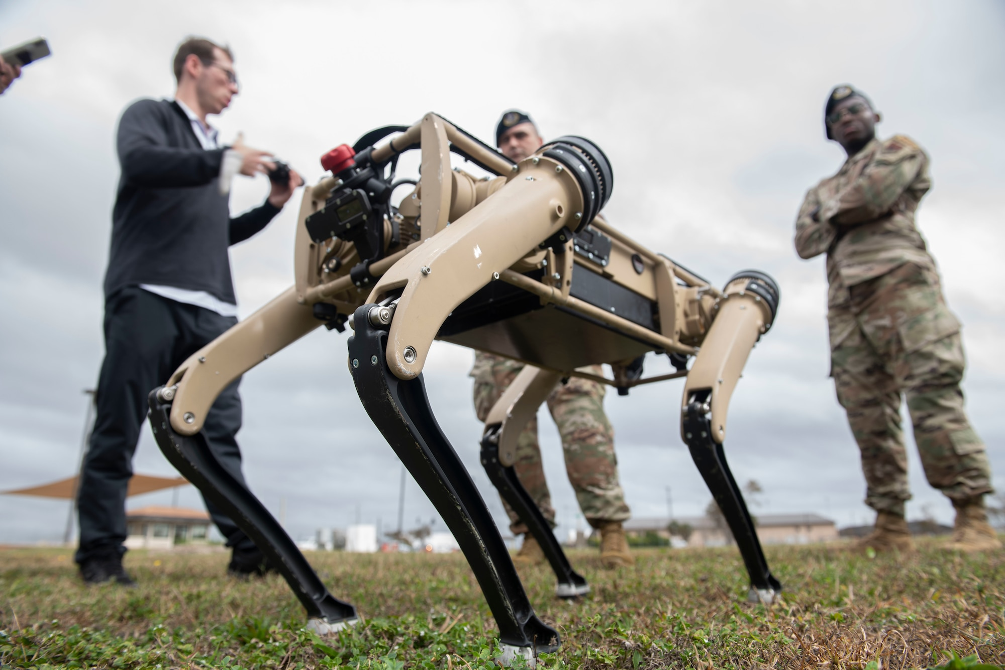unmanned ground vehicle, men standing in background