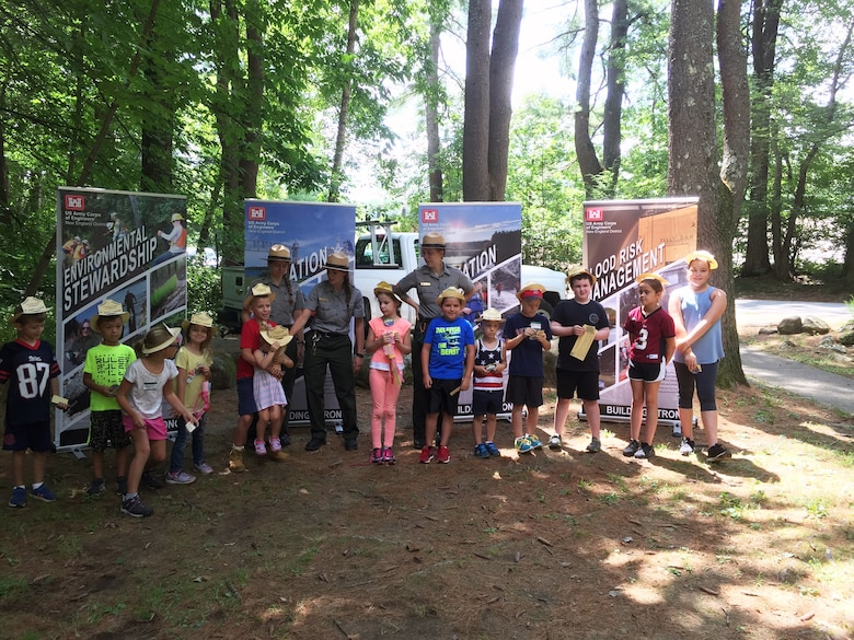 The newest Tully Lake Junior Rangers pose for a picture with their Summer Ranger mentors after the graduation ceremony.