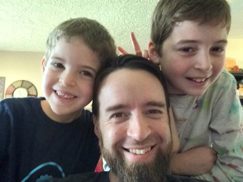 Anthony Johnson, technical writer-editor (engineering) with the U.S. Army Corps of Engineers' Portland District, in 2010 with his two sons, Ebin (far left), currently 12, and Ethan (far right), currently 16.