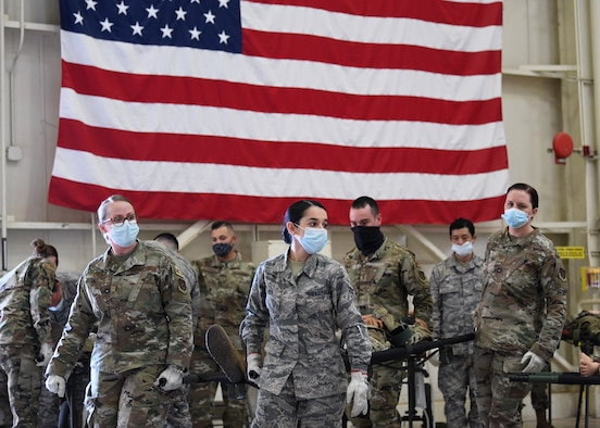 """944th Aeromedical Staging Squadron Reserve Citizen Airmen work together to carry a litter Nov. 7 at Luke Air Force Base, Arizona. The 944th Fighter Wing held a four day """"super unit training assembly"""" to complete training requirements for upcoming deployments. (Master Sgt. Louis Vega Jr.)"""