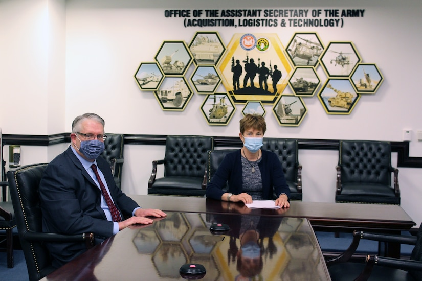 Ms. Elizabeth Wilson, Assistant Deputy Secretary of the Army for Defense Exports and Cooperation, reviews the Cyber Training Capabilities (CTC) Project Arrangement (PA) for Program Executive Office for Simulation, Training and Instrumentation (PEO STRI) with Jim Spratt, from the DASA (DE&C) Armaments Cooperation Directorate.