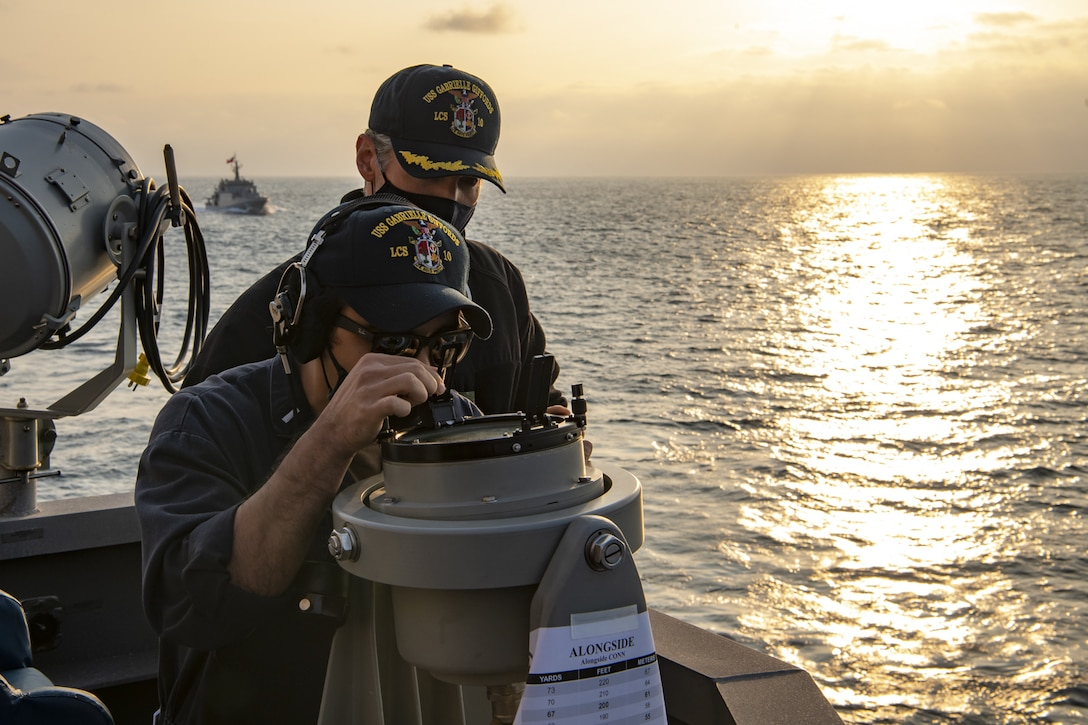 Lt. j.g. Timothy Wenholz, assigned to the Independence-class littoral combat ship USS Gabrielle Giffords (LCS 10), uses a bearing circle in preparation for a replenishment-at-sea (RAS) with the  Chilean Navy replenishment oiler CNS Almirante Montt (AO-52) Nov. 7, 2020.