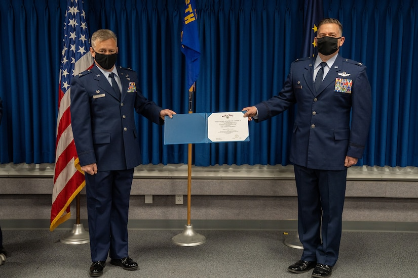 Alaska Air National Guard Col. Matthew Calabro succeeds Col. Kenneth Radford as 176th Mission Support Group commander .