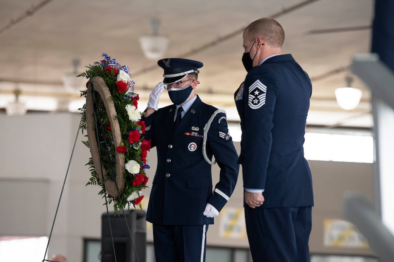 A Maxwell Air Force Base Honor Guard member salutes the wreath alongside Chief Master Sgt. Michael Morgan, 42nd Air Base Wing command chief, Nov. 11, 2020. (U.S. Air Force photo by Senior Airman Charles Welty)