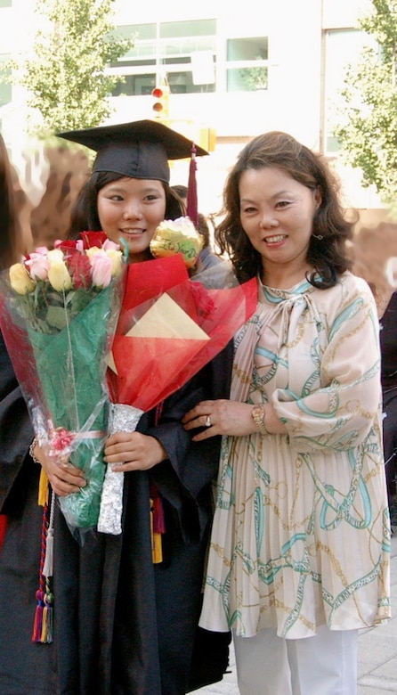 Emily is seen here with her mother at graduation.