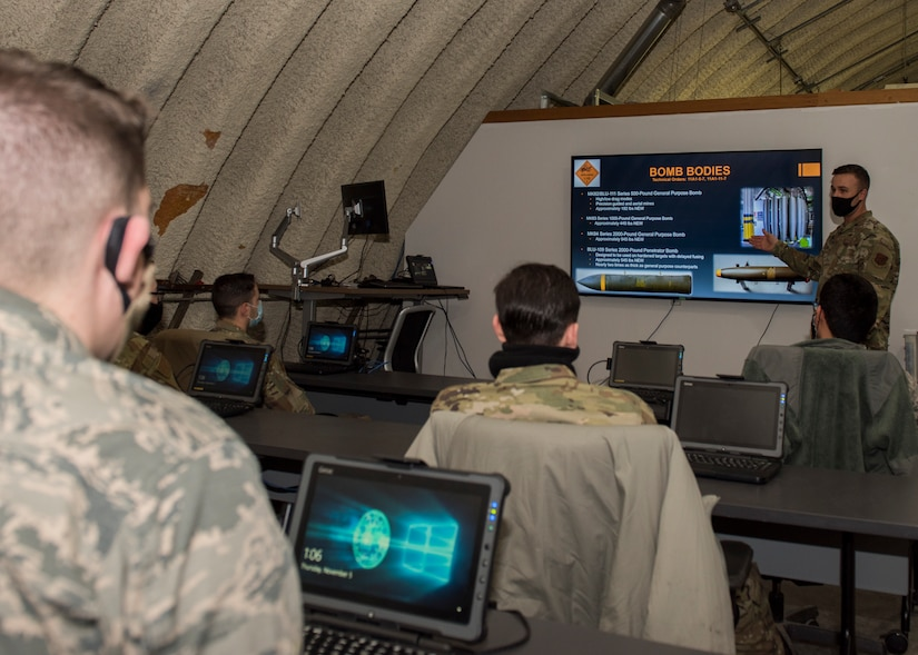 U.S. Air Force Tech. Sgt. Nicholas Kern, the 3rd Munitions Squadron training section chief, teaches a combat munitions training class at Joint Base Elmendorf-Richardson, Alaska, Nov. 5, 2020. Kern revamped his squadron's training section and implemented an expanded CMT program that familiarizes ammo troops with a variety of munitions in one location.