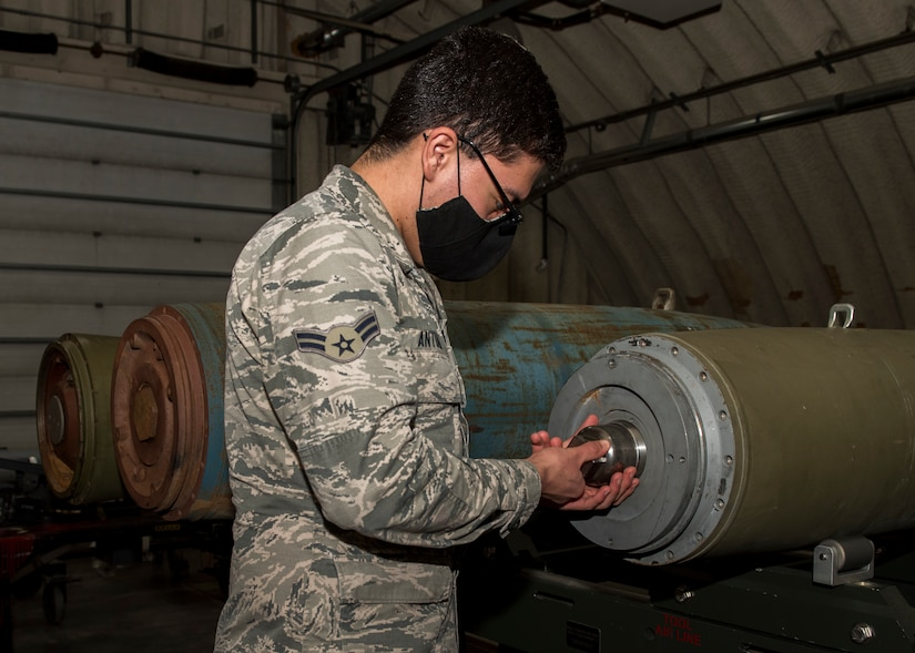 U.S. Air Force Airman 1st Class George Antuna, a 3rd Munitions Squadron precision guided munitions technician, disassembles an inert bomb at a combat munitions training class at Joint Base Elmendorf-Richardson, Alaska, Nov. 5, 2020. U.S. Air Force Tech. Sgt. Nicholas Kern, the 3rd MUNS training section chief, revamped his squadron's training section and implemented an expanded CMT program that familiarizes ammo troops with a variety of munitions in one location.