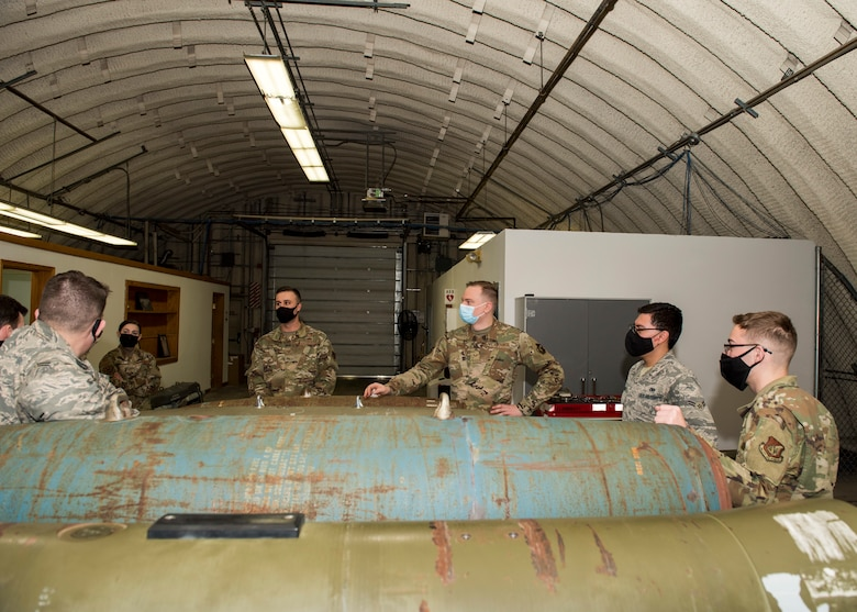 U.S. Air Force Tech. Sgt. Nicholas Kern, fourth from right, the 3rd Munitions Squadron training section chief, teaches a combat munitions training class at Joint Base Elmendorf-Richardson, Alaska, Nov. 5, 2020. Kern revamped his squadron's training section and implemented an expanded CMT program that familiarizes ammo troops with a variety of munitions in one location.