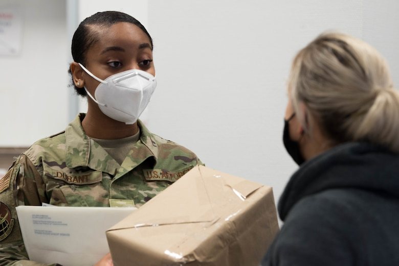 An Airman assists a customer in the Northside Post Office at Ramstein Air Base, Germany.