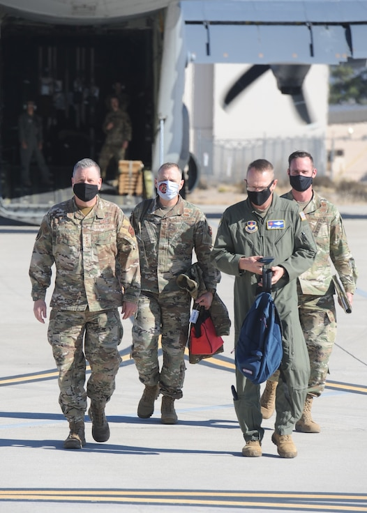 AETC senior leaders walk from aircraft to hangar.