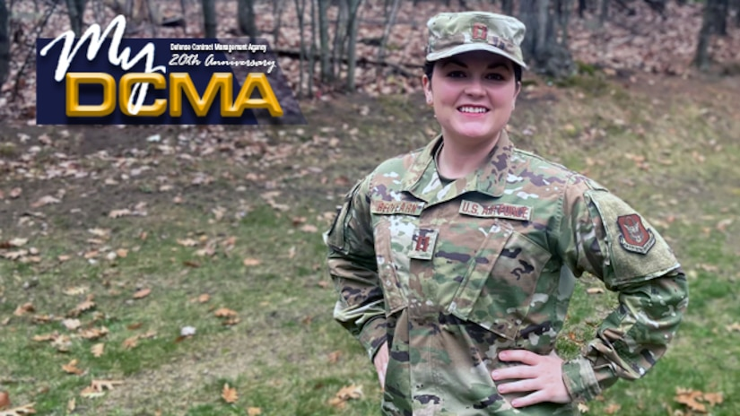 Female Air Force officer wears her military uniform and cover while standing outside