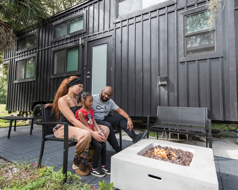 Staff Sgt. Kevin Inniss and his wife, Shanice, sit outside their recently completed Tiny Home with their 5-year-old daughter, Urie, in Cocoa, Fla.  Inniss is a computer knowledge manager with the 709th Cyberspace Squadron at Patrick AFB, Fla. (U.S. Air Force photo by Matthew S. Jurgens)