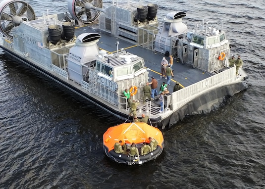 Reservists demonstrated the ability to safely deploy and board a 25-person life raft from the Landing Craft Air Cushion 100 Class in the event of an abandoned ship during a egress training Nov. 7-8.